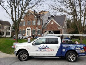 American Choice Exteriors About Us Photo of Man Us Doing Inspection