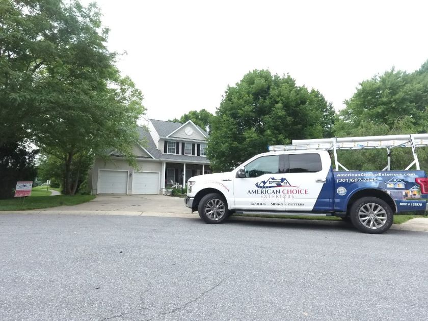 American Choice Exteriors pick up truck outside a residential home