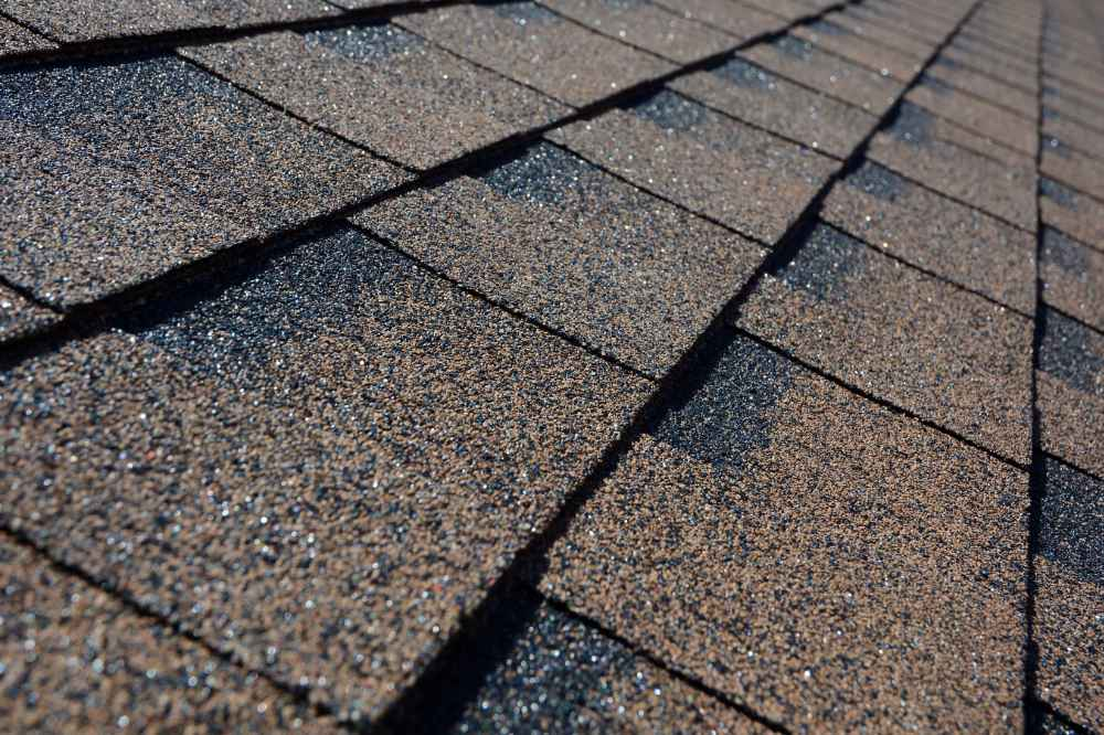 a close up view of brown colored roof shingles
