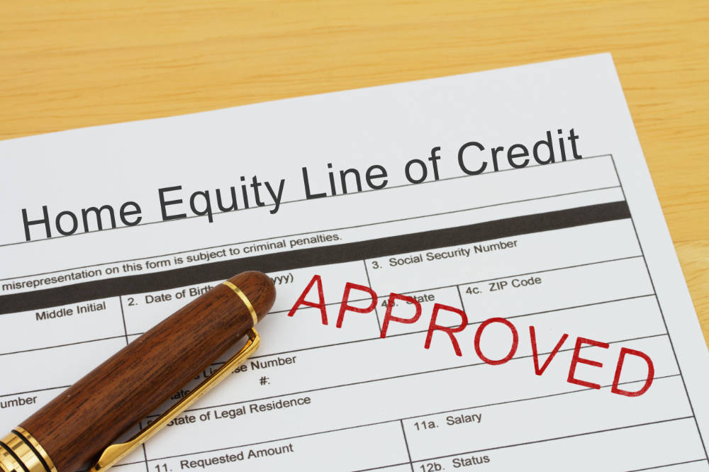 the corner of a home equity loan application with a pen